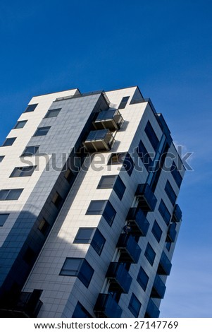 Apartment building and blue sky. - stock photo