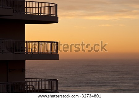 Apartment building balcony with sunset in the distance, in Surfers Paradise, Australia - stock photo
