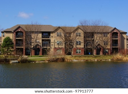 Apartment building complex with beautiful lake view - stock photo