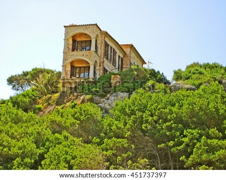 Apartment building / house, accommodation, view of balconies, green trees / bushes in front, blue sky  - stock photo