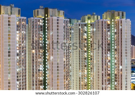 Apartment building in Hong Kong at night - stock photo