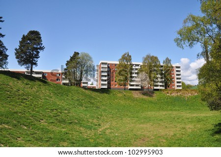 Apartment building, typical architecture in a swedish suburb from the 1970's. - stock photo