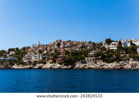 Apartment buildings by Mediterranean Sea. view of Mallorca coast, balearic islands, Spain - stock photo