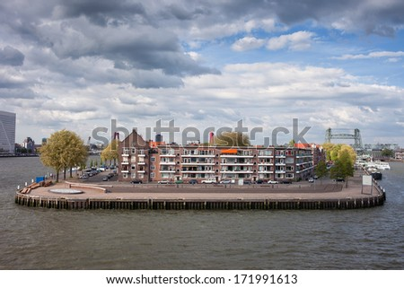 Apartment buildings on a river island in the city centre of Rotterdam, South Holland, the Netherlands. - stock photo