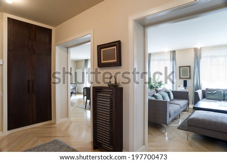 Apartment entrance interior with a view to the rooms - stock photo