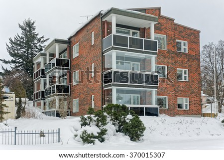 Apartment house in Finland after heavy snowstorm - stock photo