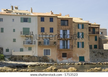 apartment houses in saint-tropez on the waterfront - danger of flood disaster - french riviera, mediterranean sea - stock photo