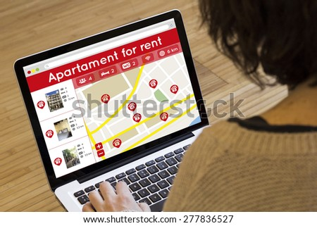 apartment search online concept: house search application on a laptop screen - stock photo