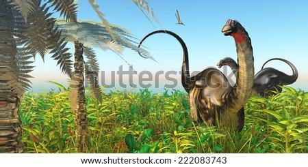 Apatosaurus Dinosaur Garden - A Pteranodon flies past two Apatosaurus dinosaurs in a lush Cretaceous jungle. - stock photo