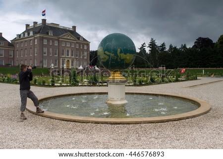 Apeldoorn, Netherlands, June 30, 2016: Baroque garden with fountain in form of globe in Het Loo in Apeldoorn, Netherlands - stock photo