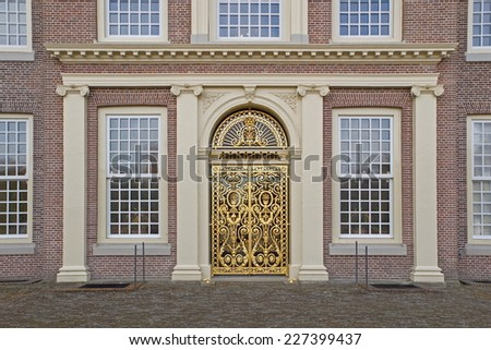 Apeldoorn, Netherlands - October 31, 2014: golden doors at the rear of Palace Het Loo in Apeldoorn. - stock photo