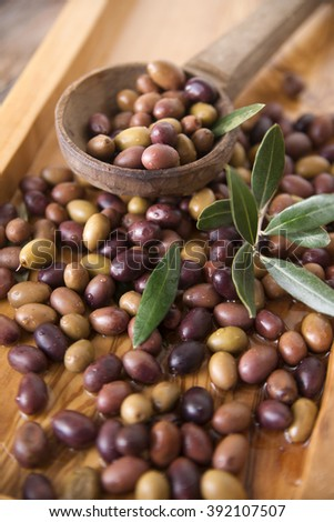 Aperitif with mixed olives in brine of Tuscany Italy - stock photo