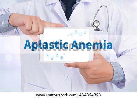 Aplastic Anemia Doctor holding  digital tablet - stock photo