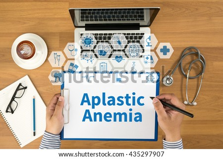 Aplastic Anemia Top view, Doctor writing medical records on a clipboard, medical equipment - stock photo