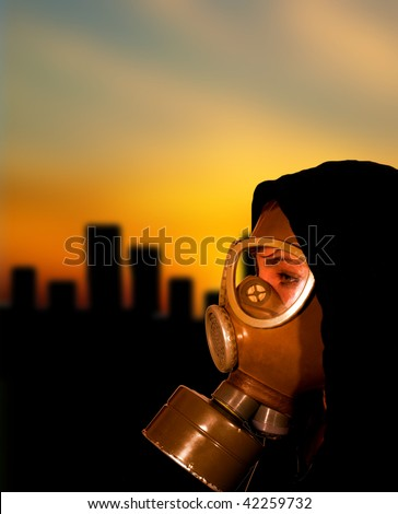 Apocalypse scene with woman in gas mask - stock photo