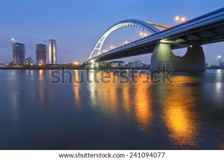 Apollo bridge and highrise buildings in Bratislava, Slovakia. - stock photo