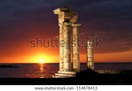 Apollo Temple at the Acropolis of Rhodes at night, Greece - stock photo