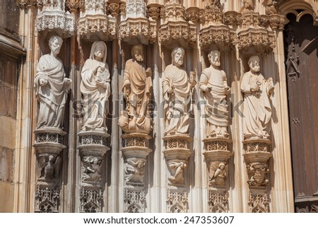Apostles statues in the main portal of Santa Maria da Vitoria monastery, Batalha, Estremadura, Portugal - stock photo