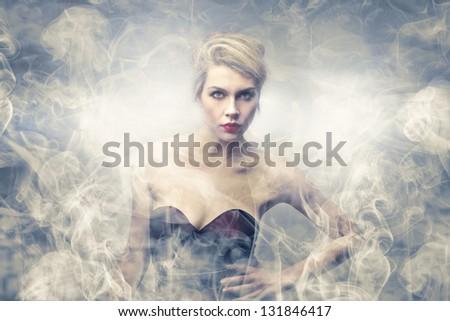 appearance beautiful woman in the smoke - stock photo