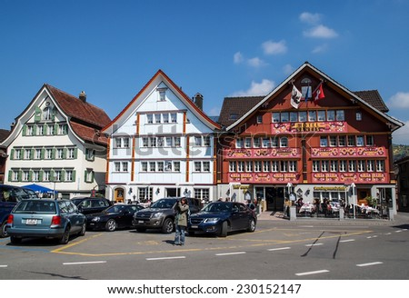 APPENZELL APR 16: lovely traditional Swiss houses in Appenzell, Switzerland on April 16, 2012. Appenzell became a full member of Swiss Confederation on 1513. - stock photo