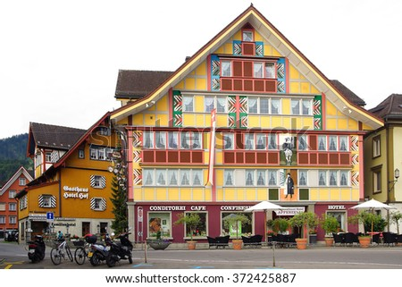 APPENZELL, SWITZERLAND- JUNE 29, 2015: Cafe-Hotel Appenzell at Hauptgasse in historic medieval old town. Appenzell is well-known for its colourful houses with painted facades. - stock photo