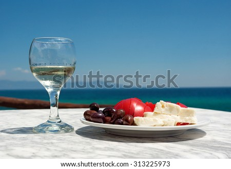 Appetizer and salad on the sea background - stock photo