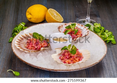 Appetizer ceviche with raw salmon and tuna - stock photo