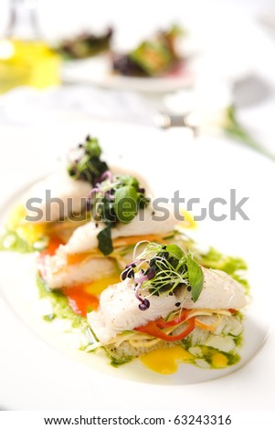Appetizer of roasted fish and vegetables - stock photo