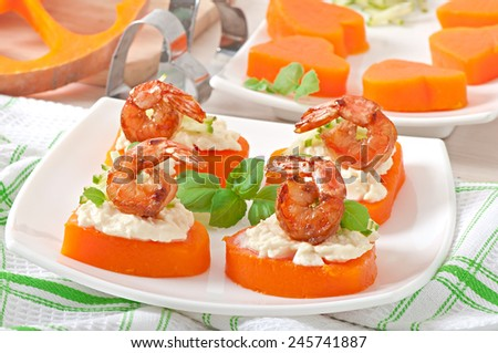 Appetizer of shrimp and cream cheese on pumpkin hearts - stock photo