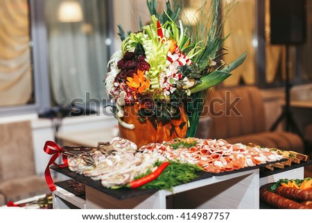 Appetizer table decorated in the ethnic style - stock photo