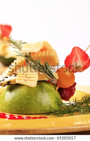 Appetizer - Two kinds of cheese and fresh fruit - stock photo