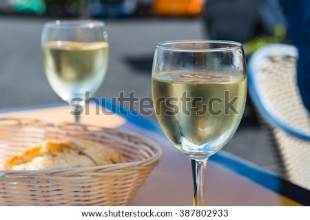 Appetizer with baguette bread and white wine for lunch  Typical and traditional meal on Lanzarote Canary Island produced by domestic farmers - stock photo