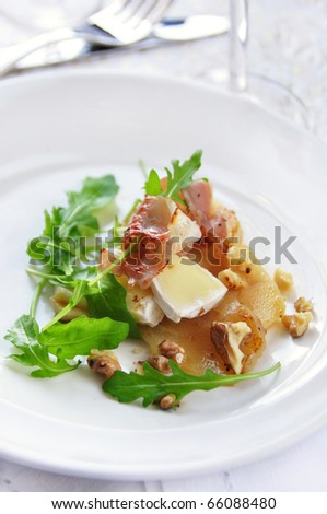 appetizer with pear, cheese and ham - stock photo