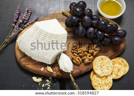 appetizer with ricotta. lavender, grapes, walnuts, olive oil and crackers - stock photo