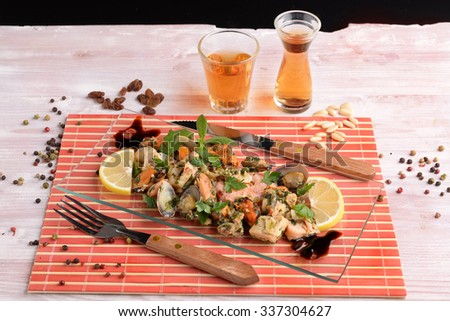 Appetizer with shellfish and fish on glass dish - stock photo