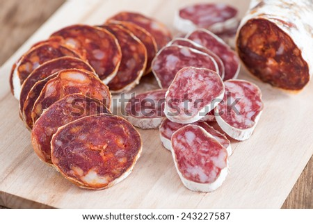 Appetizer with slices of sausage (chorizo) - stock photo