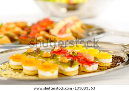 Appetizers mini desserts on catering buffet white tablecloth - stock photo