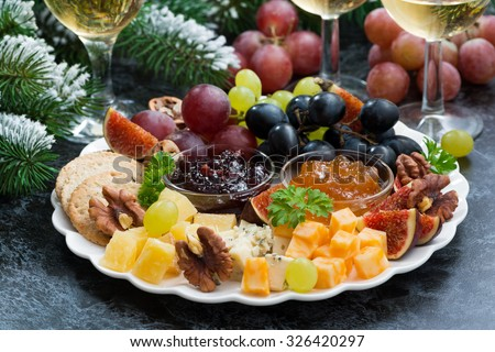 appetizers to the holiday - cheeses, fruits and jams, horizontal - stock photo