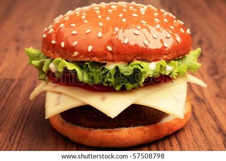 Appetizing cheeseburger. Isolated over white background. - stock photo