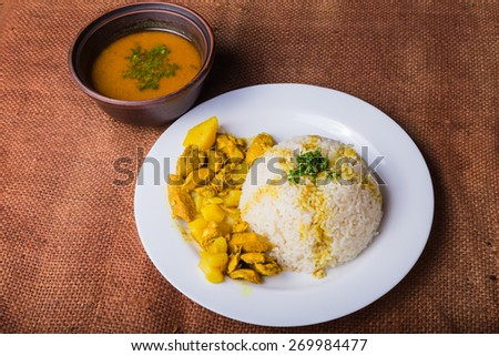 Appetizing, delicious pilaf with meat on a plate. - stock photo