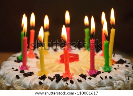 appetizing holiday cake with the light colorful candles - stock photo