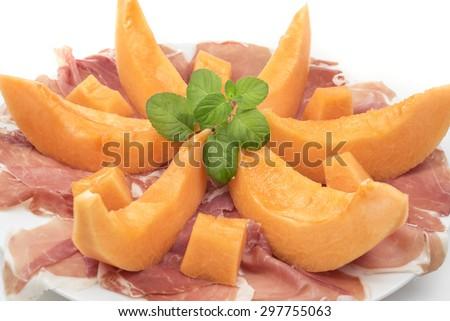 appetizing starter of ham and melon - stock photo