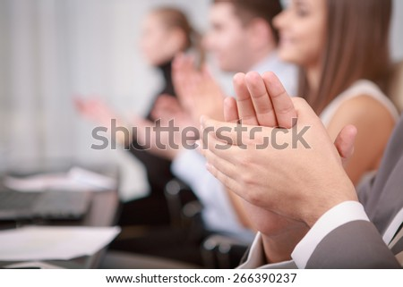 Applause. Close-up of male hands applauding at the business meeting - stock photo