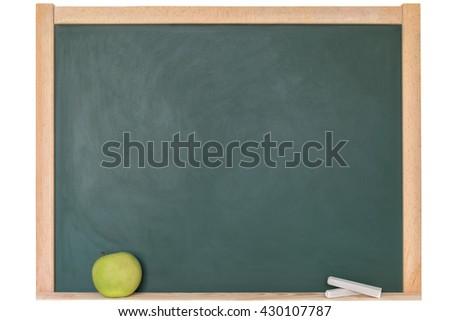 Apple against a blackboard - stock photo