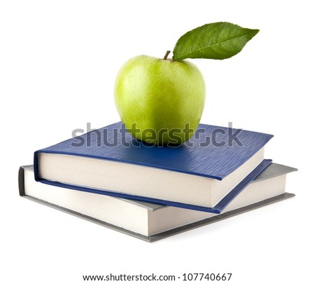 Apple and books on a white background - stock photo