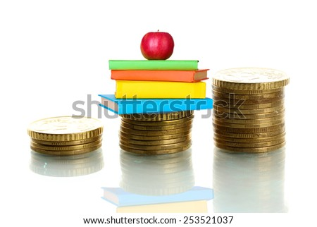 Apple and books standing on stack of coins isolated on white - stock photo