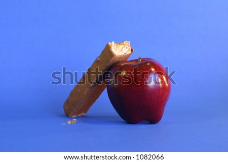 Apple and candy bar - stock photo