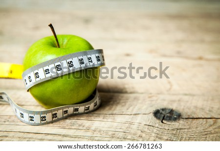 Apple and centimeter. Healthy eating - stock photo