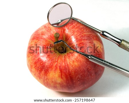 apple and dental tools  - stock photo