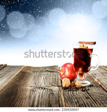 apple and glass of mulled  - stock photo